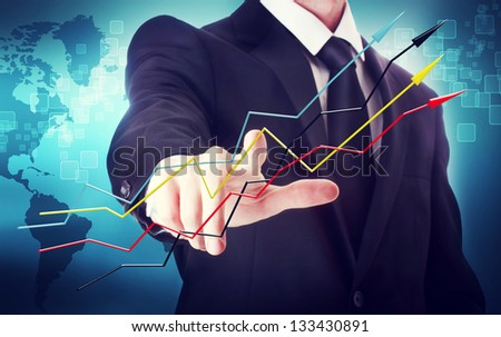 Businessman with arrows representing growth - stock photo
