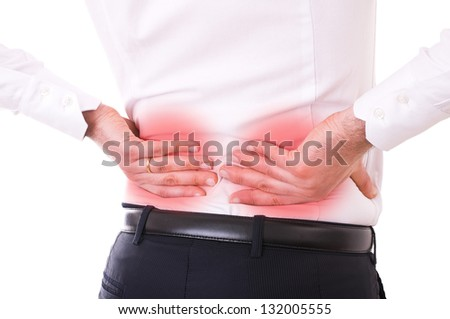 Businessman with backache. - stock photo