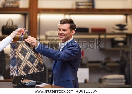 Businessman with bag at a counter - stock photo