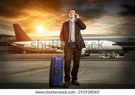 Businessman with baggage in airport - stock photo