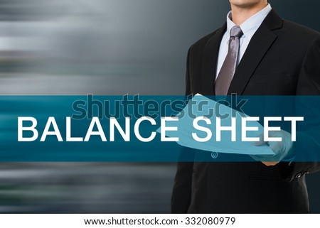 Businessman with BALANCE SHEET WORD - stock photo