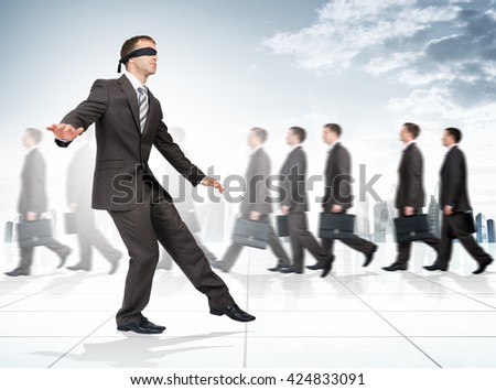 Businessman with bandage on his eyes among people - stock photo