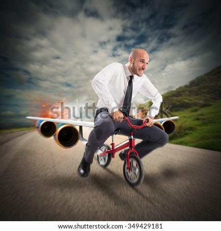 Businessman with bicycle with the aircraft turbines - stock photo