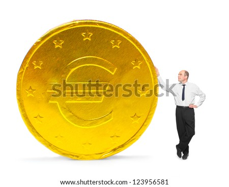 Businessman with big golden coin. Investment and saving concept. - stock photo