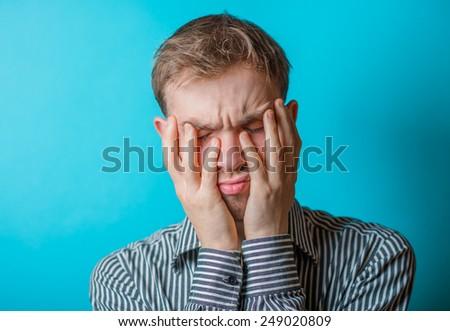 Businessman with big headache touching head  - stock photo