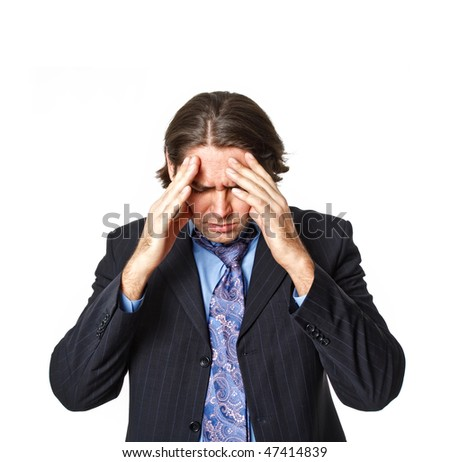 Businessman with big headache touching head on white background