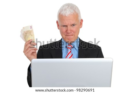 Businessman with Bills and Laptop on Sofa isolated