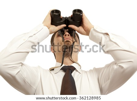 Businessman with binoculars isolated on white - stock photo