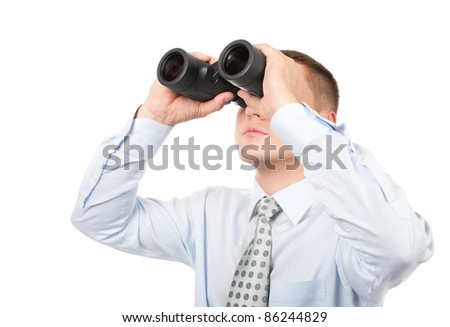 Businessman with binoculars isolated on white background - stock photo