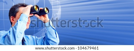 Businessman with binoculars. Techno futuristic background. - stock photo