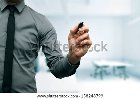 businessman with black marker in the hand at the office - stock photo