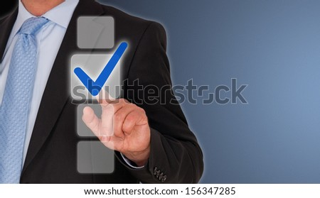 Businessman with blue check box - stock photo