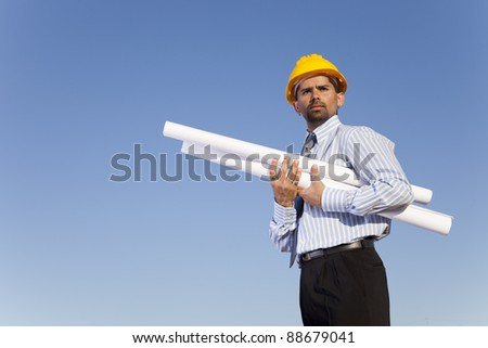 Businessman with blue prints in the outdoor