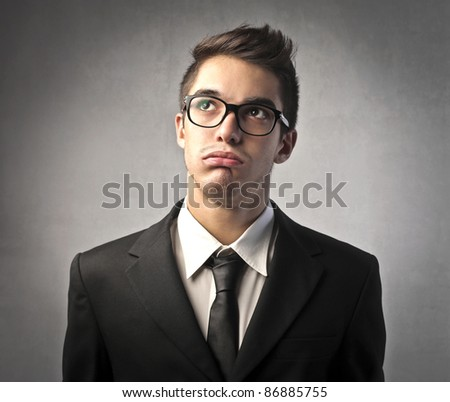 Businessman with bored expression - stock photo