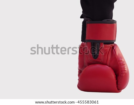 Businessman with boxing gloves and white copy space background, business fight concept - stock photo