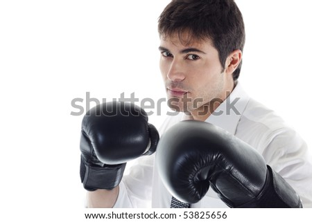 Businessman with boxing gloves. Concept: competition, aggressiveness. - stock photo
