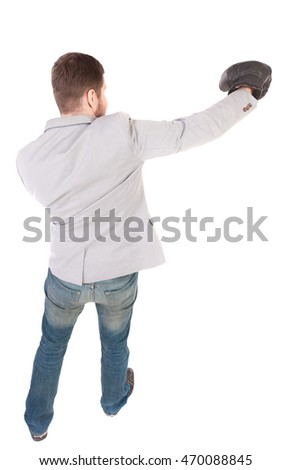 businessman with boxing gloves in fighting stance. Isolated over white background. Rear view people collection.  backside view of person. Top view of a businessman strikes in boxing gloves.
