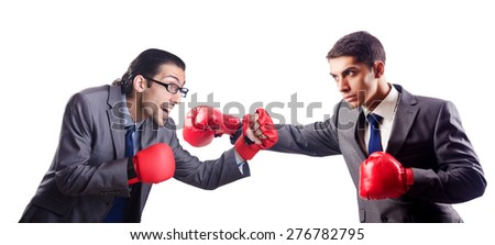 Businessman with boxing gloves on white - stock photo