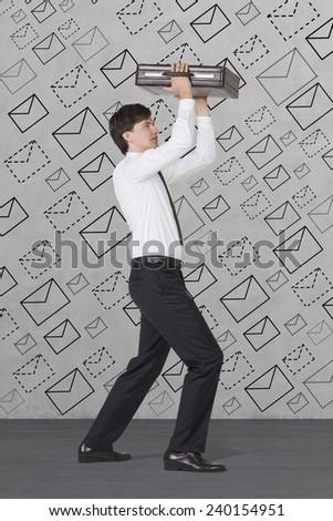 businessman with briefcase and drawing email rain - stock photo