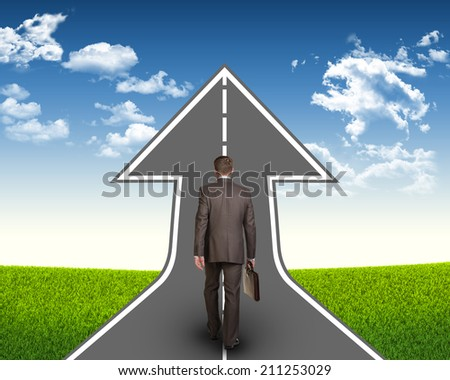 Businessman with briefcase on the road - stock photo