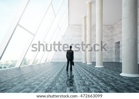 Businessman with briefcase standing in interior design with concrete columns, panoramic city view and daylight. 3D Rendering