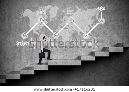 Businessman with briefcase walking up on stairs. Drawing start up concept on wall - stock photo