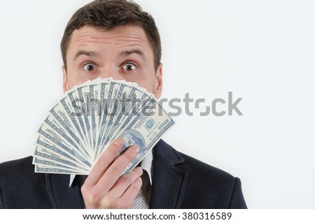 Businessman with bundle of money in studio on a white background. Success concept - stock photo