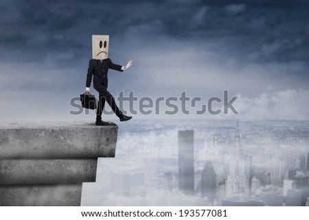Businessman with cardboard head concept for lost, searching, confusion and challenge - stock photo