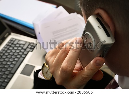Businessman with cellphone - stock photo
