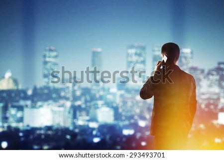 businessman with cellphone  looking to modern city - stock photo
