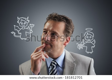 Businessman with chalk drawing angel and devil on his shoulders concept for conscience, decisions, uncertainty or moral dilemma - stock photo