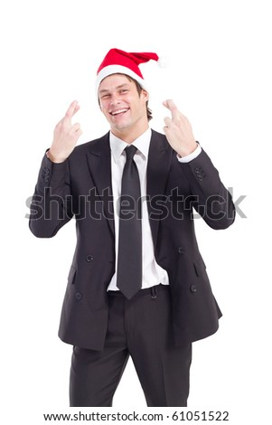 businessman with Christmas hat cross fingers - stock photo