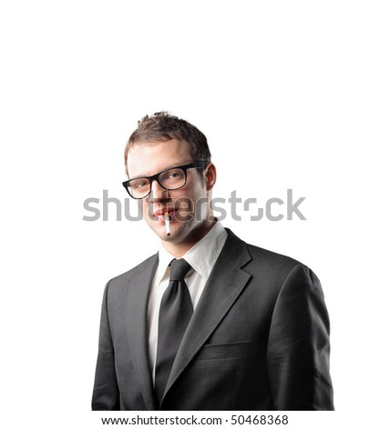 Businessman with cigarette - stock photo