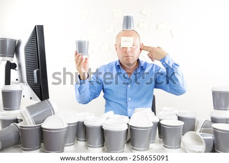 Businessman with coffee addiction - stock photo