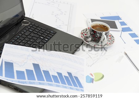 Businessman  with coffee and laptop analyzing of the  monitoring profit dynamics in the company - stock photo