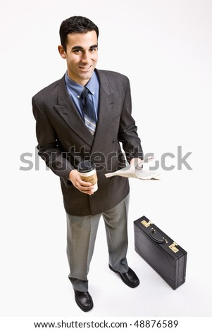 Businessman with coffee and newspaper - stock photo