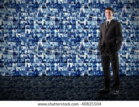 businessman with composition of portraits on the background - stock photo
