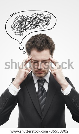 Businessman with confusing tangle of thoughts. Thinking man. Conceptual image of a open minded man. On a gray background - stock photo