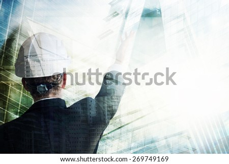 Businessman with construction helmet - stock photo