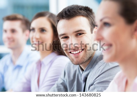 Businessman with coworkers - stock photo