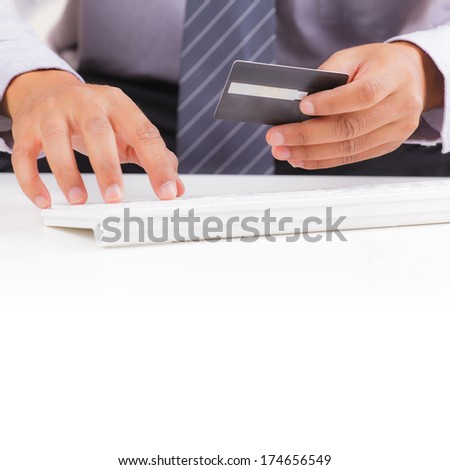 Businessman with credit card, on line shopping