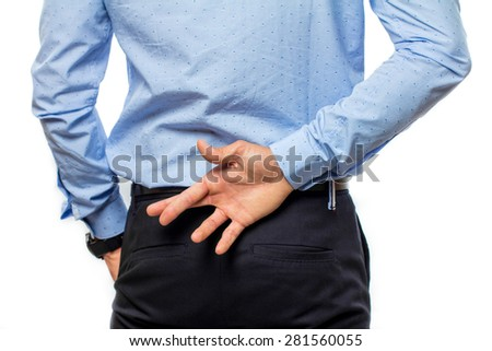 Businessman with crossed fingers - stock photo