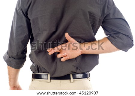 Businessman with crossed fingers behind his back