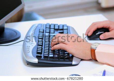 Businessman with desktop PC at office