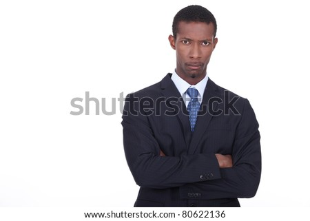 Businessman with determined expression on face - stock photo