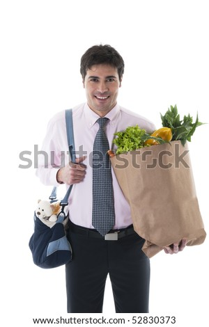 Businessman with diaper bag and shopping bag. Concept: modern man, multi-tasking