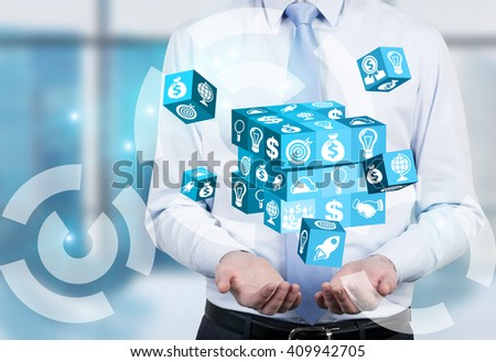 Businessman with digital cube puzzle in hands - stock photo