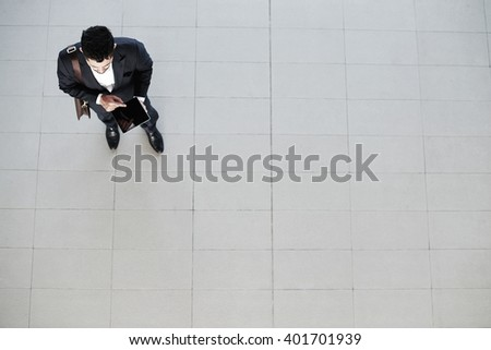 Businessman with digital tablet, view from the top - stock photo