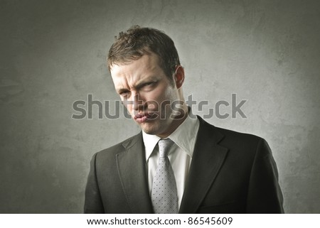 Businessman with disappointed expression - stock photo