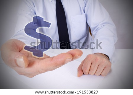 businessman with dollar in hand